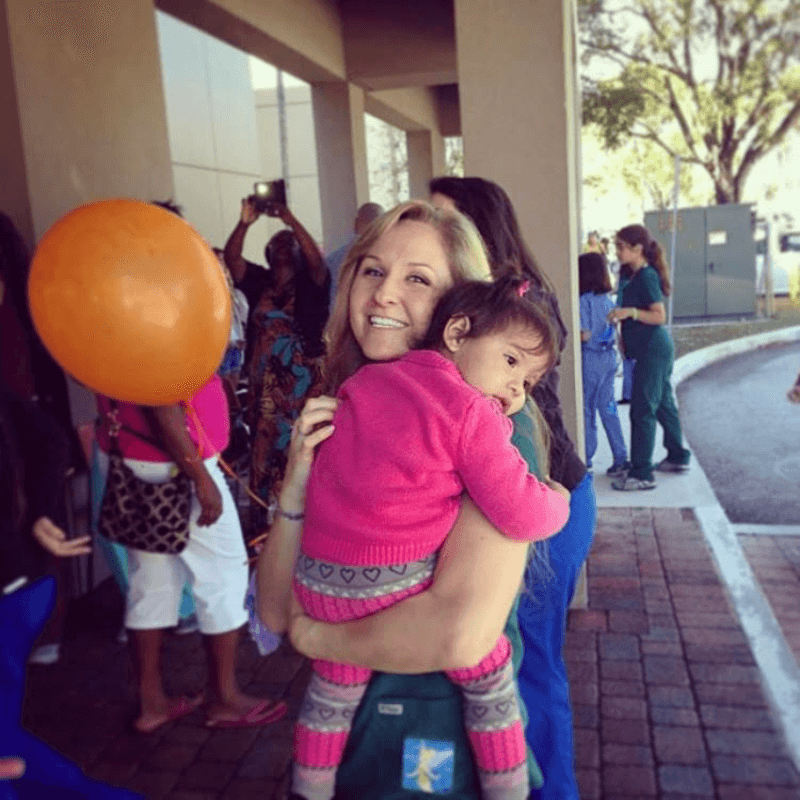 Dr. Anne getting a hug - Camp Little Tooth Pediatric Dentistry